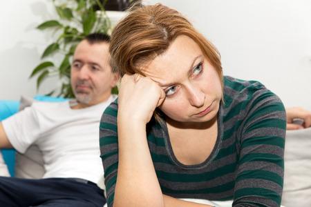 marital: Man and woman at home in a marital dispute