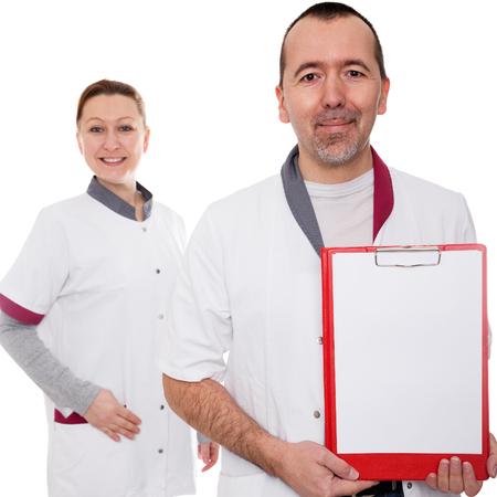doctor is holding a clipboard, nurse standing in background isolated on white photo