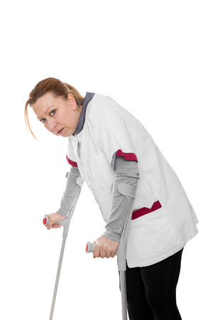 revised: female revised nurse is limping, isolated on white