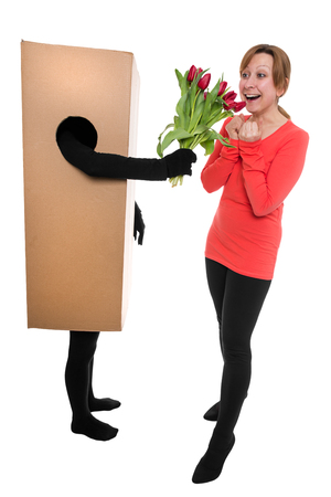deliverer: woman and package deliverer with flowers  Stock Photo