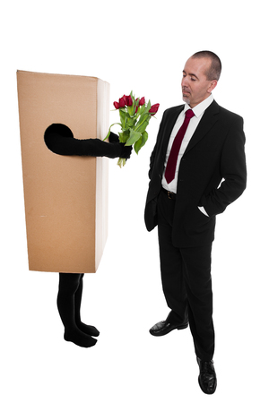 convey: package delivery to convey flowers to a businessman Stock Photo
