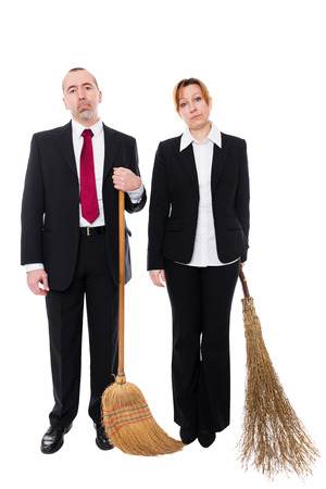 qualified worker: group of business people with brooms Stock Photo