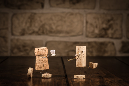 Concept marriage proposal with wine cork figures