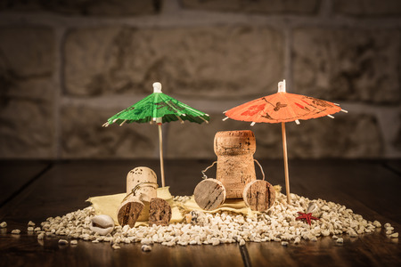humanly: Concept Holiday on a Beach with wine cork figures