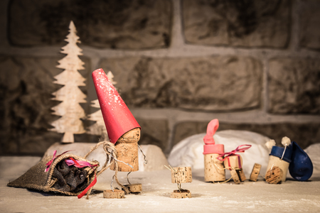 manlike: Concept Santa Claus with presents of wine cork figures Stock Photo