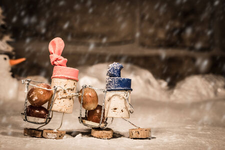 humanly: Concept harvesting icewine by wine cork figures Stock Photo