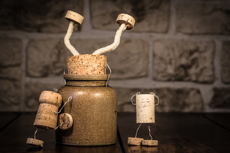 wood figurine: Concept stucking in a pot with wine cork figures Stock Photo