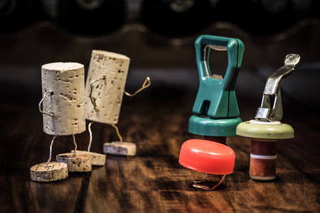 humanly: various bottle caps in a competition of wine cork figures Stock Photo