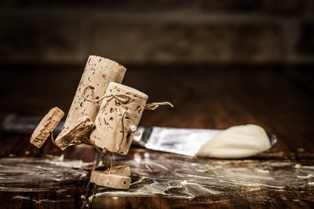 humanly: Concept couple is skating on buttered table of wine cork figures