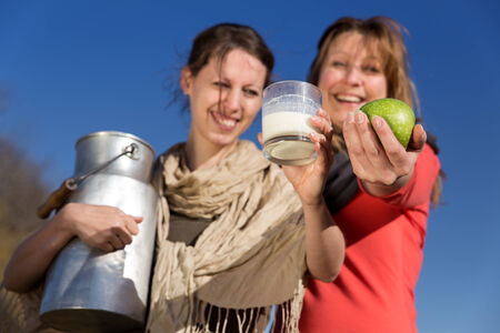 Two beautiful women present healthy bio food photo