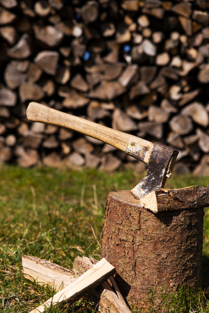wooden block with a ax and split wood photo