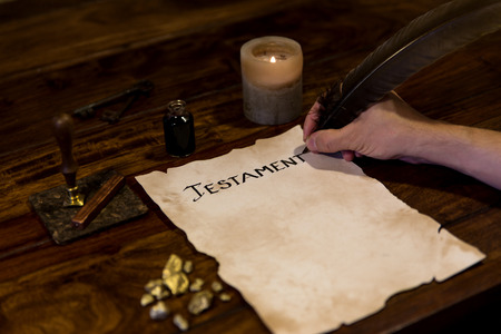 old writing: Man wrote his last will on a parchment