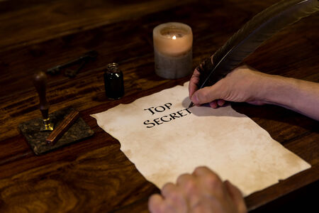 Man is writing on a paper Top Secret photo
