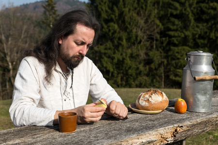 long haired: Hermit man in nature picnic