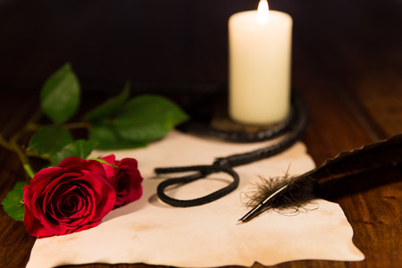 letter, whip, candle and rose photo