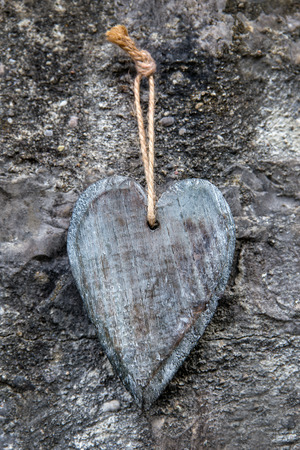 vintage wooden heart in front of a rocky background photo