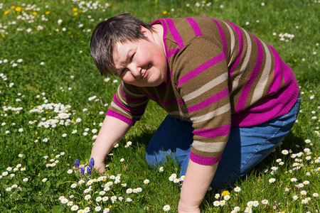 mentally disabled woman on a meadow