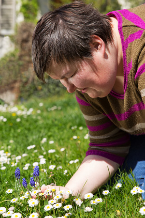disabled woman is sitting on a green meadow Stock Photo - 27664175