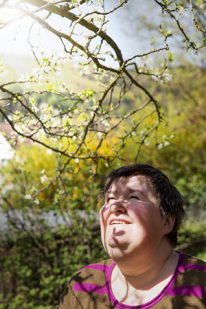 mentally: mentally disabled woman under a plum tree Stock Photo