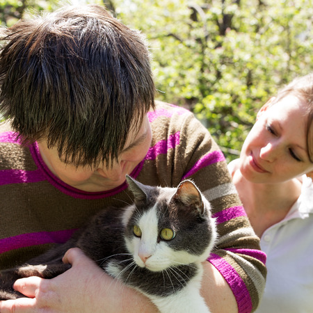 disabled woman cuddles a cute cat photo