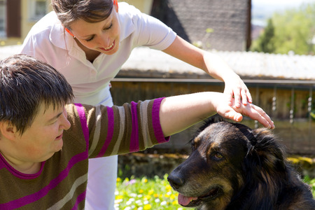 people with disabilities: animal assisted therapy with a half breed dog Stock Photo