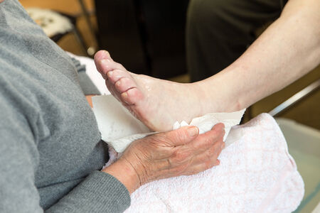 a podologist in preparation of a treatment of the feet photo