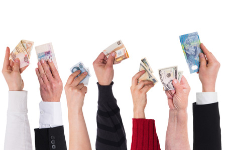 different currencies holding by different hands Stockfoto