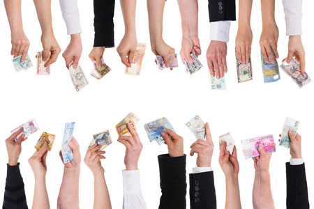 collectives: a lot of hands with important currencies isolated on white Stock Photo