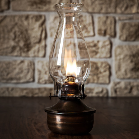 kerosene lamp: Vintage oil lamp on a wooden table