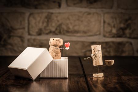 Concept love present with wine cork figures
