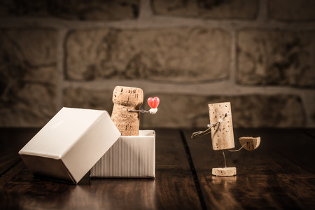 Concept love present with wine cork figures