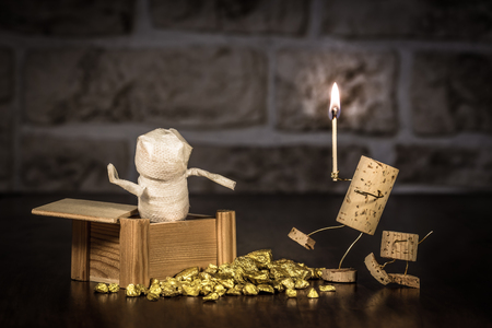 manlike: Concept Adventurer with a mummy, wine cork figures Stock Photo
