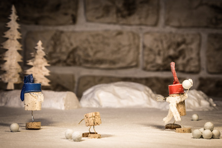 humanly: Concept Snowballs and Children, wine cork figures