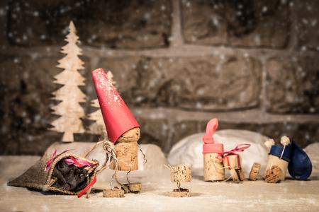 icescape: Concept santa claus and Children, wine cork figures
