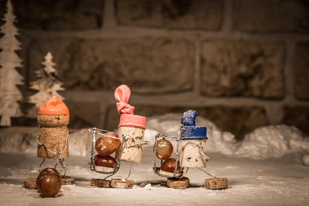 humanly: Concept harvester harvest wine grapes, wine cork figures Stock Photo