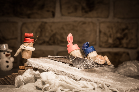 humanly: Concept funny sledging with wine cork figures