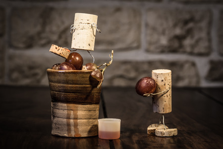Concept grape juice pressing with wine cork figures