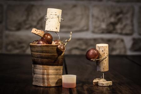wood figurine: Concept grape juice pressing with wine cork figures
