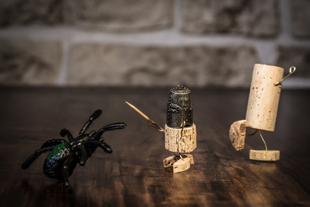 humanly: Concept bravery Knight with Spider, wine cork figures Stock Photo