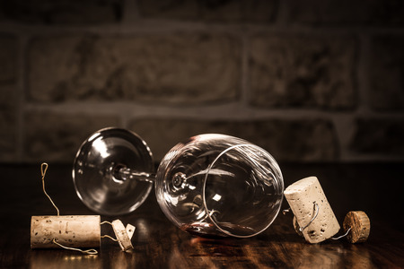 tipsy: Concept tipsy men with wine cork figures Stock Photo