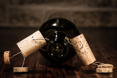 humanly: Concept Sickness because too many wine with cork figures Stock Photo