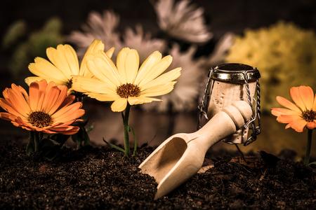 humanly: Concept landscaper planting flowers, wine cork figures