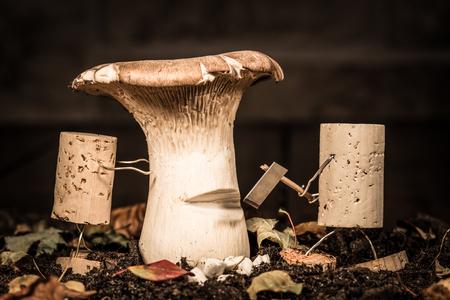 humanly: Concept Woodsman felling a mushroom, wine cork figure