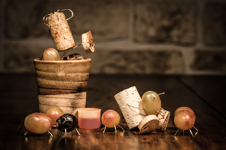 humanly: Concept squeezing grape juice with wine cork figures Stock Photo