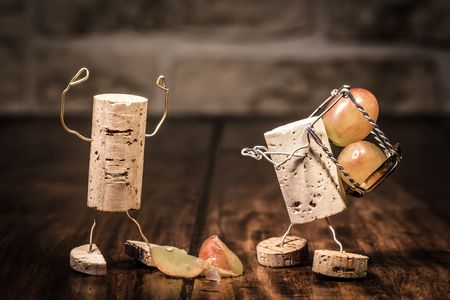 humanly: Concept Trouble between boss and employee, wine cork figures Stock Photo