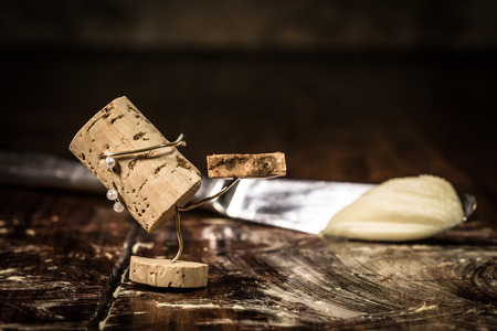 humanly: Concept figureskating on buttered table with wine cork figure Stock Photo
