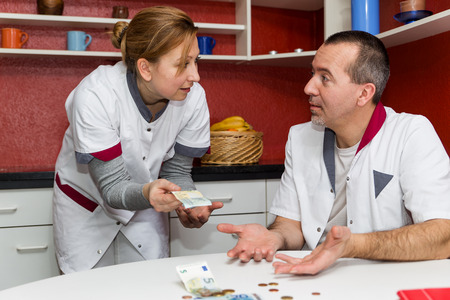 break down: two nurses are talking concept hospital is getting more expensive Stock Photo