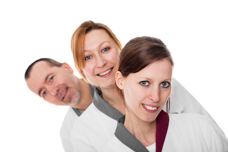 three nurses watching the viewer, isolated on white
