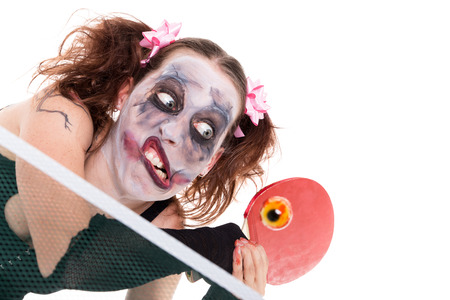 halloween concept with creepy female clown, isolated on white photo