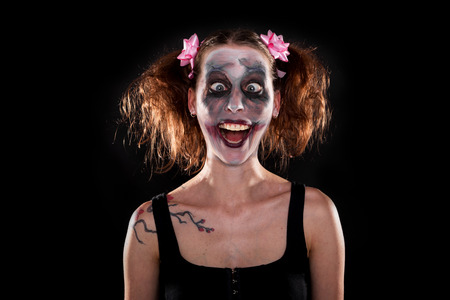 insane funny female clown in front of black photo
